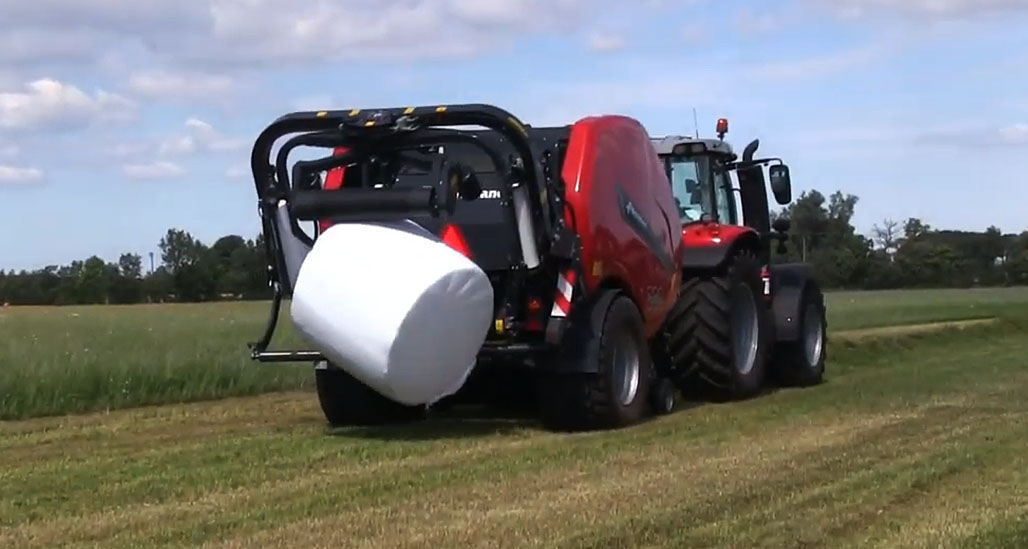 The bale is gently placed onto the ground with no rolling momentum.