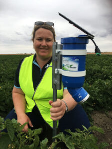 CSIRO's Dr Rose Brodrick with a prototype WaterWise sensor in tomatoes.