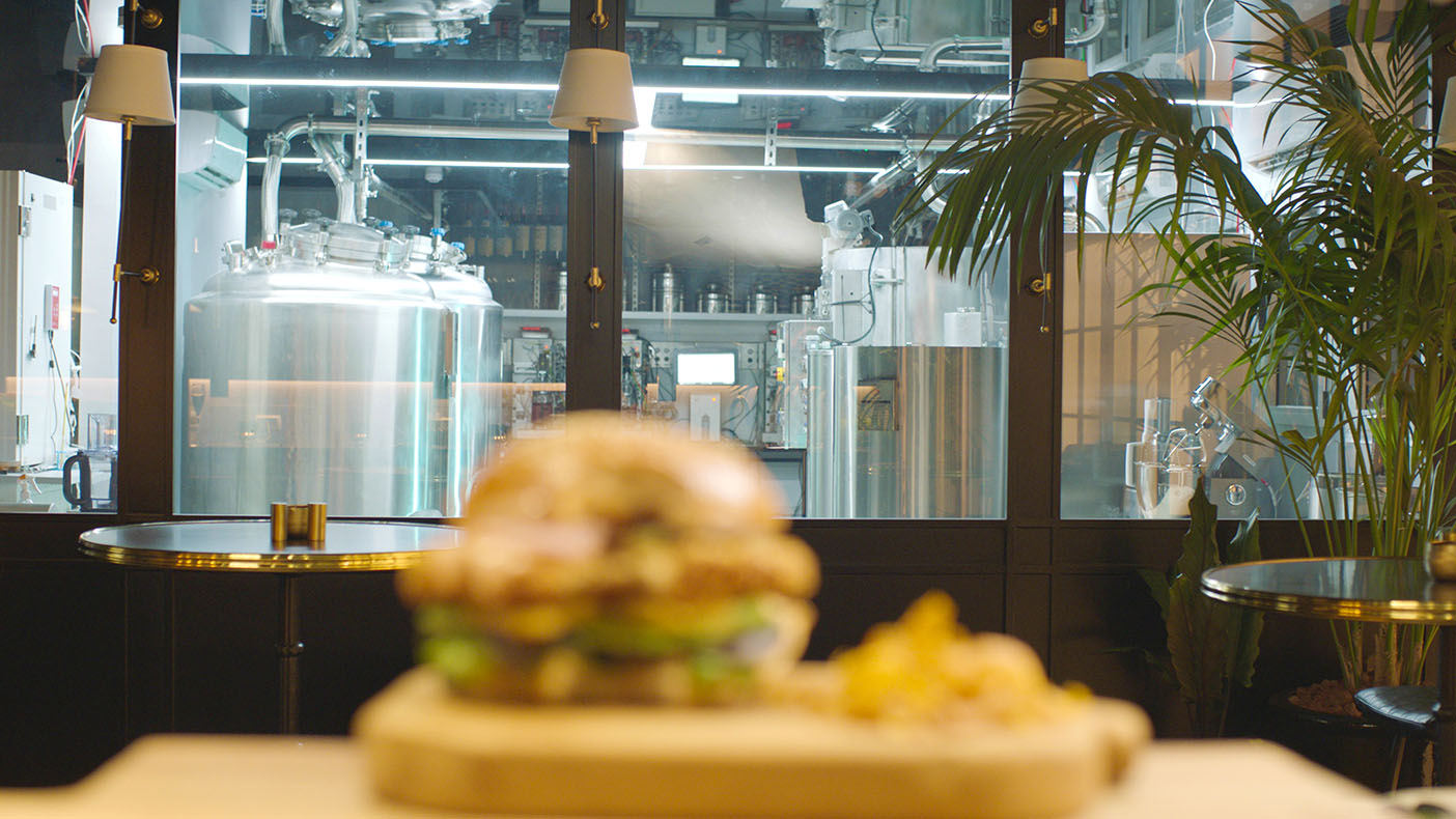 Eat your chicken burger and watch the food being grown