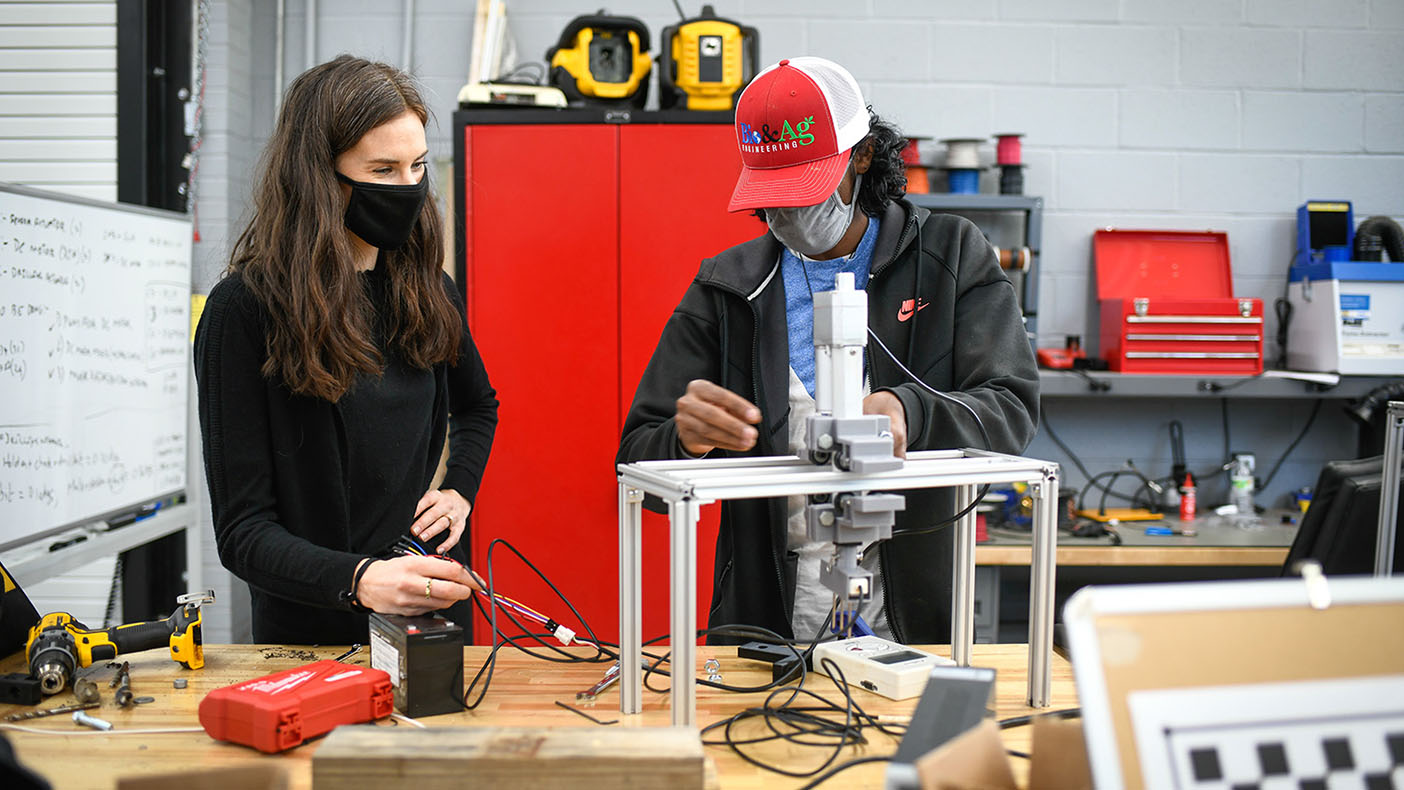 Sierra Young, left, and doctoral student Hemanth Narayan Dakshinamurthy are part of a team of NCSU researchers working to integrate unmanned surface and aerial vehicles to improve farming of oysters and other shellfish. (Photo by Marc Hall)
